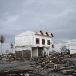 A two-story house damaged by the tsunami showing the tsunami inundation height in downtown Banda Aceh.